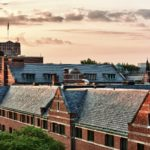 The roof of West Quad looking onto the top of Michigan Union at dusk.